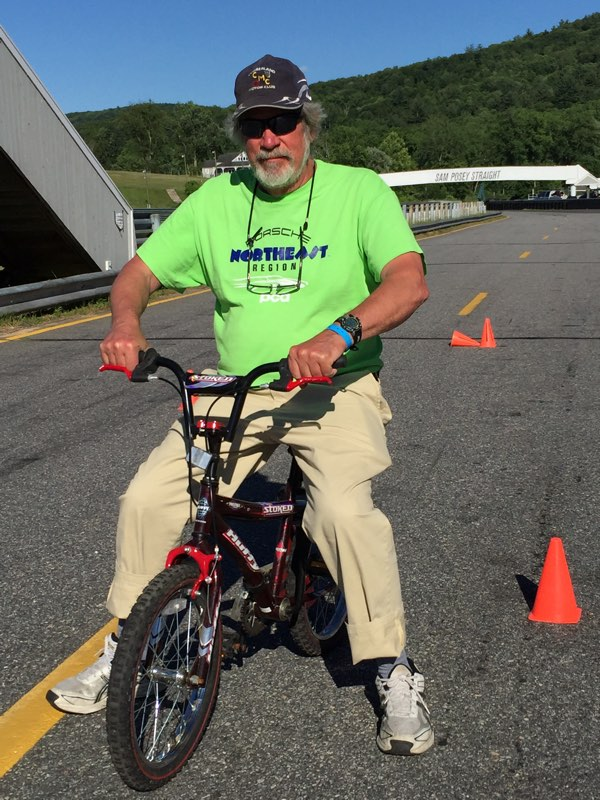 scruffy on stoked bike at Lime Rock preparing for the NER Summer Party