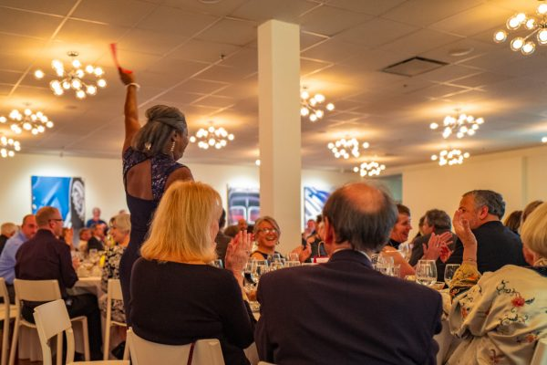 Betty Mae Mosley wins a great auction prize at the Northeast Region Porsche Club annual gala