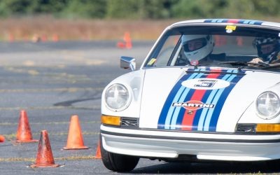 Tom Tate navigates the autocross cones in his Martini livery classic Porsche 911