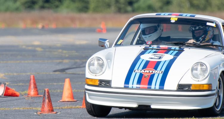 Tom Tate navigates the autocross cones in his Martini livery classic Porsche 911